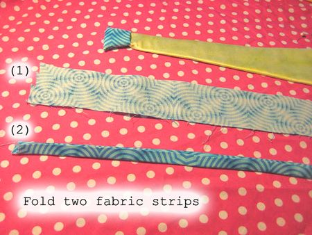 Fold two fabric strips